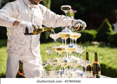 Catering service. Wedding slide champagne for bride and groom outdoors. Colorful glasses for alcohol. Business, catering service. Catering bar for celebration. Beauty of interior for wedding day.