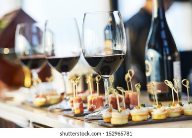 catering services background with snacks and glasses of wine on bartender counter in restaurant - Shutterstock ID 152965781