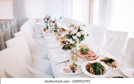 Catering services and table decoration. glasses set and dish with food meal in the wedding restaurant