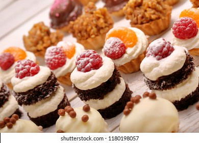 Catering sweets, closeup of various kinds of cakes on event or wedding reception