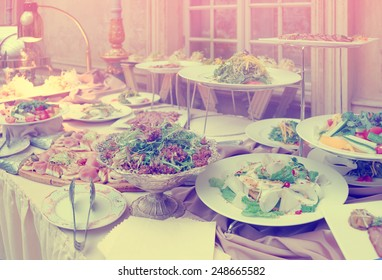 Catering table full of food, no people, toned image