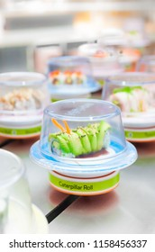 Caterpillar roll on plate moving at conveyor belt sushi restaurant
