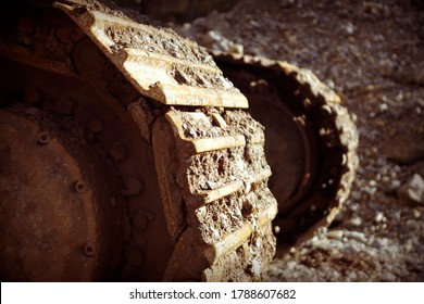 Caterpillars wheel on backhoe. Close-up of metal tracks of a crawler crane with steel wheels. Chassis tracked vehicles.
