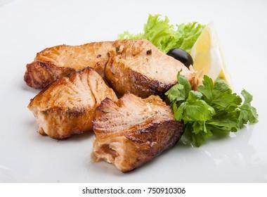 Catfish kebab , skewered fish with green