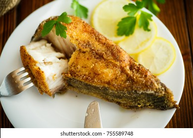 catfish roasted in batter on a wooden table