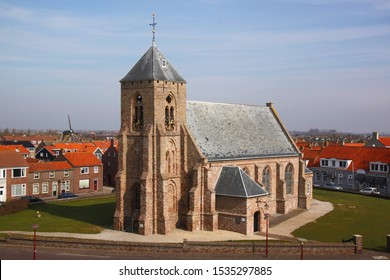 The Catharinakerk church in Zoutelande village with its gothic brick tower in Veere, Zeeland, the Netherlands
