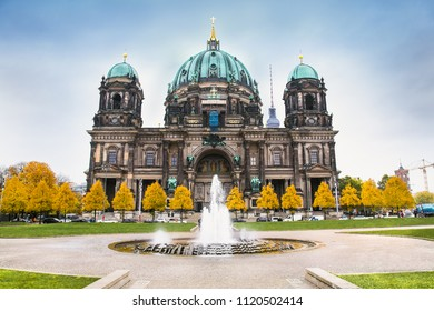 Cathedral Berliner Dom in Berlin city, Germany. Modemer Brunnen fountain on the foreground