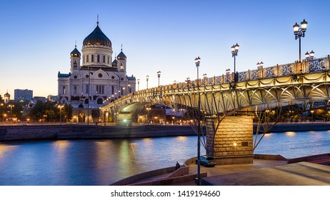 Cathedral of Christ the Savior and Patriarshy bridge at dusk, Moscow, Russia. This place is a landmark of Moscow. Nice panorama of Moscow with Moskva River in evening. Moscow cityscape in twilight.