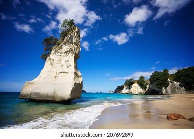 Cathedral Cove, Coromandel Peninsula, North Island, New Zealand. Empty beach on a sunny summer day.