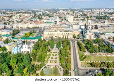 Cathedral descent, Holy Protection Monastery and the Assumption Cathedral in the city of Kharkov. Place for walking. Green alleys. Golden domes of churches. Ukraine, Kharkiv