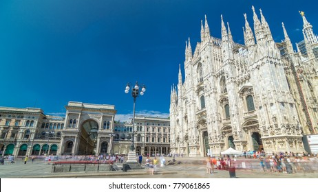 Cathedral Duomo di Milano and Vittorio Emanuele gallery timelapse hyperlapse in Square Piazza Duomo at sunny summer day, Milan, Italy. People walking on the square. Blue cloudy sky
