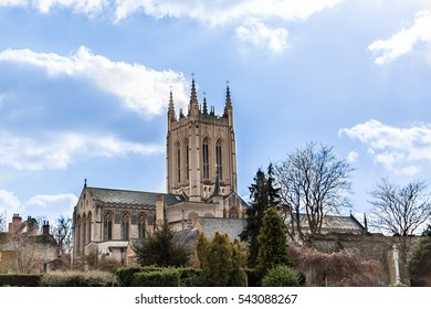 A Cathedral in England in a sunny day in autumn. An ancient and big building with a large gardens