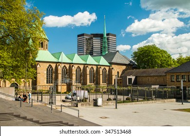 Cathedral in Essen, Germany, and modern business tower, city skyline