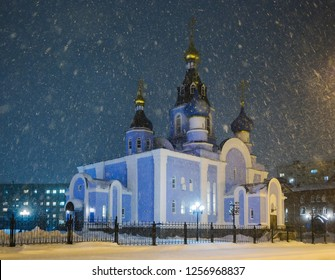 Cathedral in Norilsk city in Siberia. Snowfall on a cold winter evening. Krasnoyarsk region, Russia.