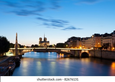 """The cathedral of Notre-Dame in the background and the bridge """"Pont de la Tournelle"""" in the foreground"""
