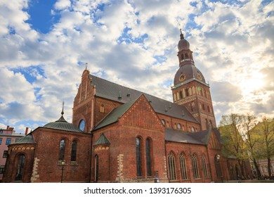 Cathedral on Dome Square (Doma Laukums) on a sunny day with clouds in a blue sky, in Riga, Latvia.