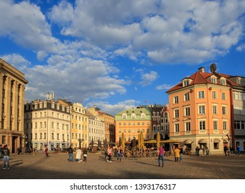 Cathedral on Dome Square (Doma Laukums) in the old town, full of tourists, with colorful buildings on a sunny day with clouds in a blue sky, in Riga, capital of Latvia May 01.2019.