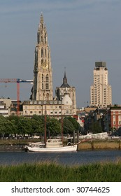 "The Cathedral of Our Lady and the ""Farmer's tower"" in Antwerp at the river Scheldt."