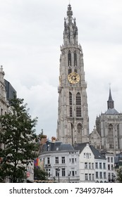 Cathedral of Our Lady (Onze-Lieve-Vrouwekathedraal), Antwerp, Belgium on an overcast day. Cathedral of Our Lady Antwerp Gothic clock tower amongst houses in the city of Antwerp near the Grote Markt.