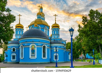 Cathedral of Our Lady's Nativity in summer evening at sunset. Blue stone cathedral church with golden domes against majestic sky. Russian architecture monument, popular landmark. Ufa,Bashkiria, Russia