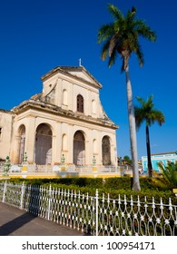 The Cathedral and palm trees on the central square of the colonial town of Trinidad in Cuba, a famous touristic landmark on the island