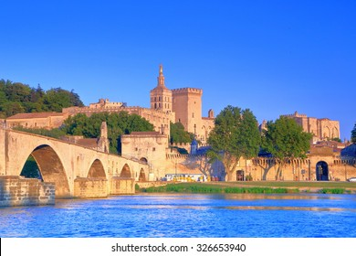 The Cathedral and Papal Palace (Palais des Papes) near the old bridge across Rhone river, Avignon, Provence, France