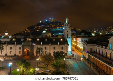 The cathedral of Quito at night and a view over the Main Square (Plaza Grande) of the city and the Panecillo with the Virgin of Quito, Ecuador, South America.