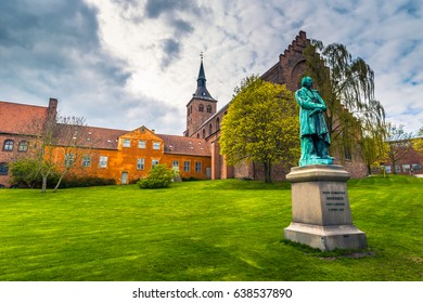 Cathedral of Saint Canute and Statue of Hans C Andersen in Odense, Denmark