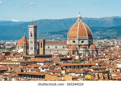 Cathedral of Santa Maria del Fiore in Florence, Italy. Beautiful cityscape image with red roofs of renaissance and medieval architecture.
