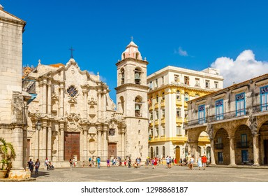 Cathedral Square with catholic church, bell tower and old buildings, historical center of Old Havana, Cuba