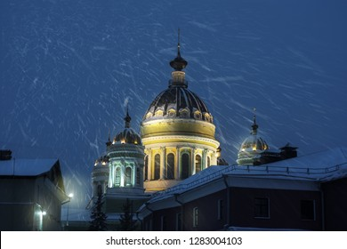 The cathedral square and the dome of the cathedral at night are illuminated with lights. Russia, Rybinsk