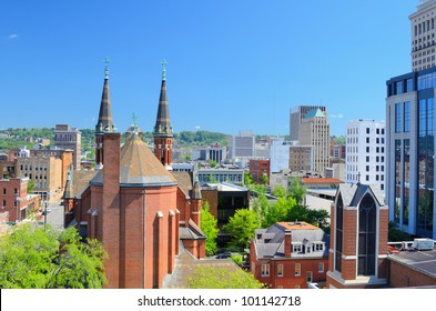 Cathedral of St. Paul amongst the skyline of downtown Birmingham, Alabama, USA.