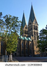 the cathedral St. Petri in Bremen, Germany on a sunny summer day in evening light in front of blue sky