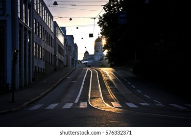 Cathedral and tram rails at sunset
