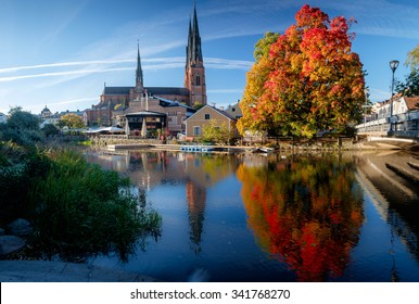 The cathedral of Uppsala next to magnificent fall colors