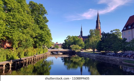 The cathedral of Uppsala with its reflection on the river. Uppsala, Sweden, Spring 2018.