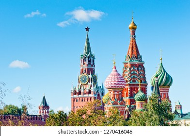 The Cathedral of Vasily the Blessed (Saint Basil's Cathedral) and the Spasskaya Tower of Moscow Kremlin. Sunny day. Red Square. Russia