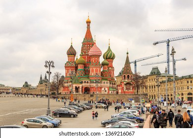 Cathedral of Vasily the Blessed (Saint Basil's Cathedral) is church in Red Square in Moscow, Russia - 03/30/2019. Cathedral of Intercession of Most Holy Theotokos on Moat. Tourists walk around square