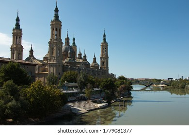 Cathedral-Basilica of Our Lady of the Pillar and the bridge Puente de Santiago over the river Ebroin in Zaragoza,Spain,Europe