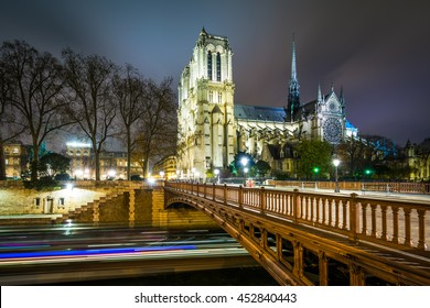 The Cathedrale Notre-Dame de Paris and Pont au Double at night, in Paris, France.
