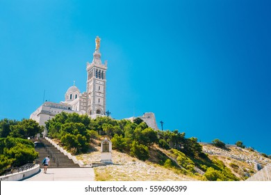 Catholic Basilica of Our Lady of the Guard or Notre Dame De La Garde church at hill in Marseille, France. Sunny summer sky.