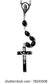 Catholic black wooden beads with metal crucifix isolated on white background