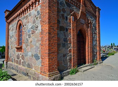 A Catholic cemetery chapel built in 1818 in the village of Lachowo in Podlasie, Poland. - Shutterstock ID 2002636157