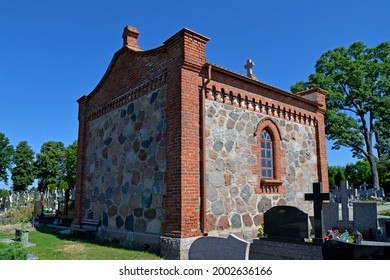 A Catholic cemetery chapel built in 1818 in the village of Lachowo in Podlasie, Poland. - Shutterstock ID 2002636166