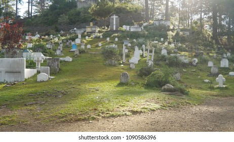 Catholic cemetery with white tombstones, graves and crosses in the mountain province of Sagada. Philippines, Luzon.