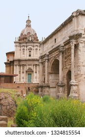 The Catholic Church of Santi-Luca-e-Martin and the Triumphal Arch of Septimius Sever at the Roman Forum