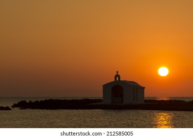 Catholic Church As Silhouette Against The Sunrise In Georgioupolis, Crete, Greece