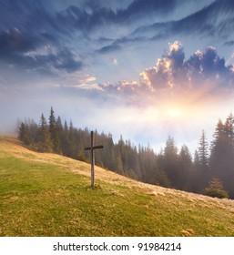 Catholic cross on a mountaintop