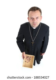 Catholic priest with collection plate