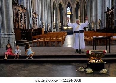 A Catholic priest during a Baptism of newborn child in the Saint Waltrude Collegiate Church in Mons, Belgium on Sep. 16, 2018